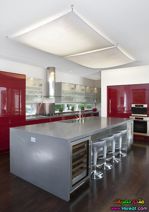 glossy-dark-red-cabinets-and-silver-kitchen-island.jpg